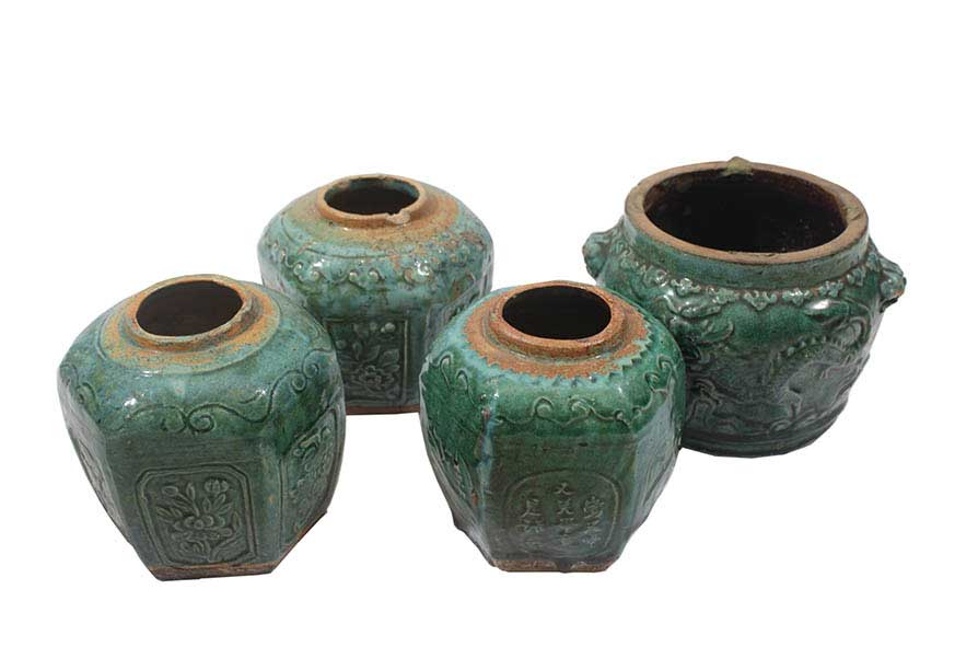 Four late 19th - early 20th century Shiwan green-glazed jars