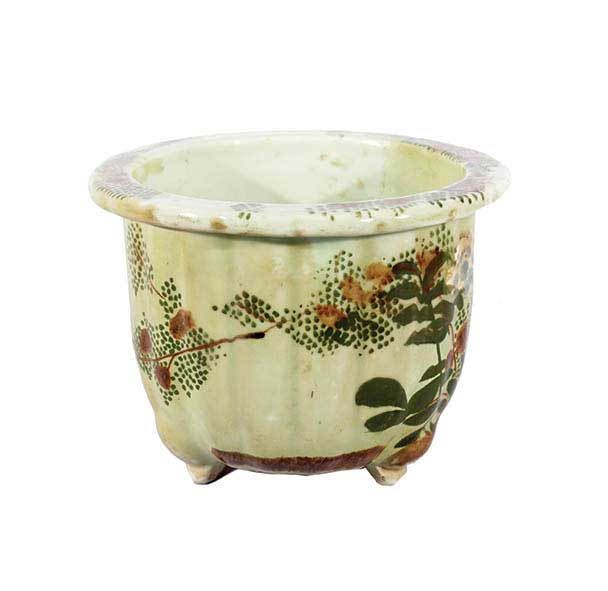A celadon ceramic planter pot with flower decoration.