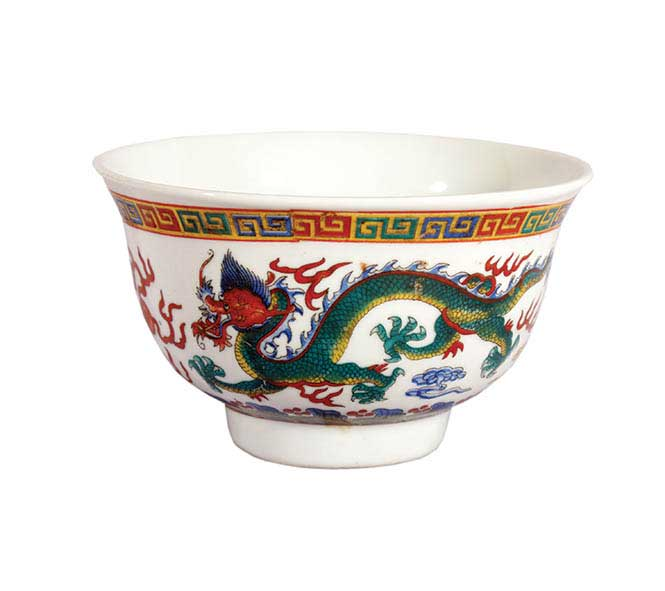 A ceramic green dragon bowl