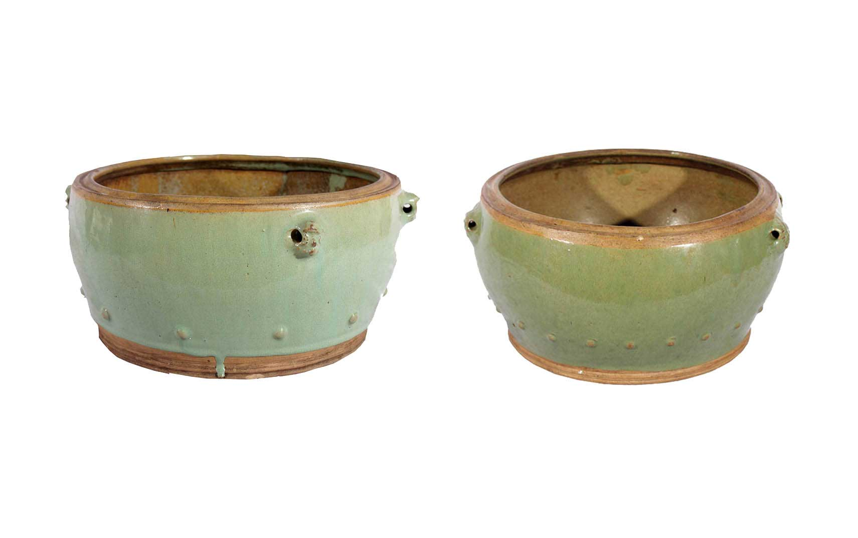 A set of two green-glazed bowls