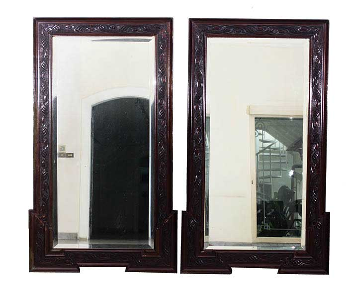 A set of two wooden framed mirrors