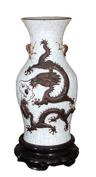 A pair of ceramic vases with dragon decorations