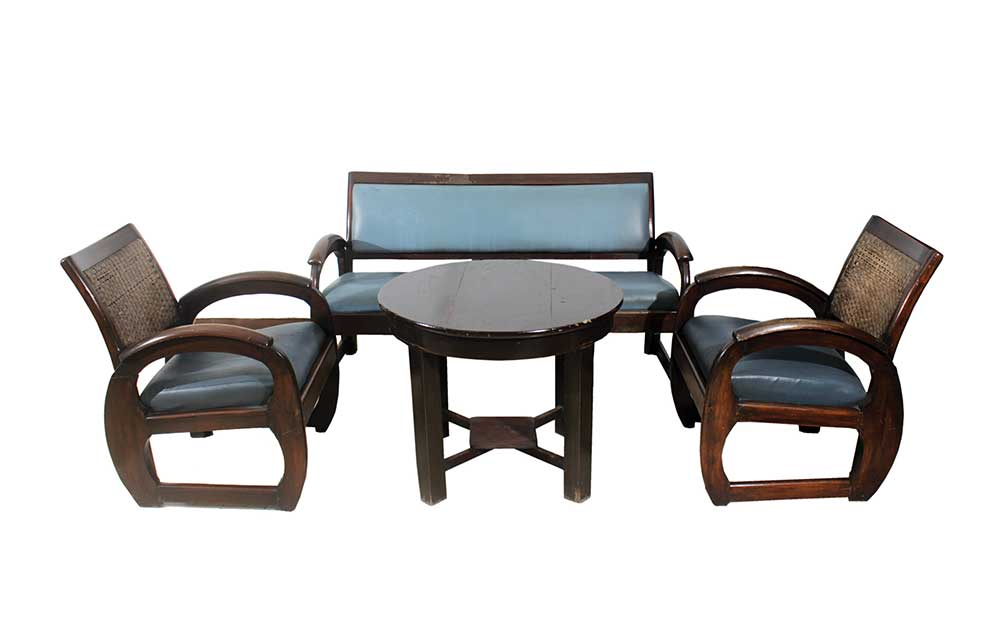 A set of wooden furniture consisting of three-seater sofa, two arm chairs and wooden round table