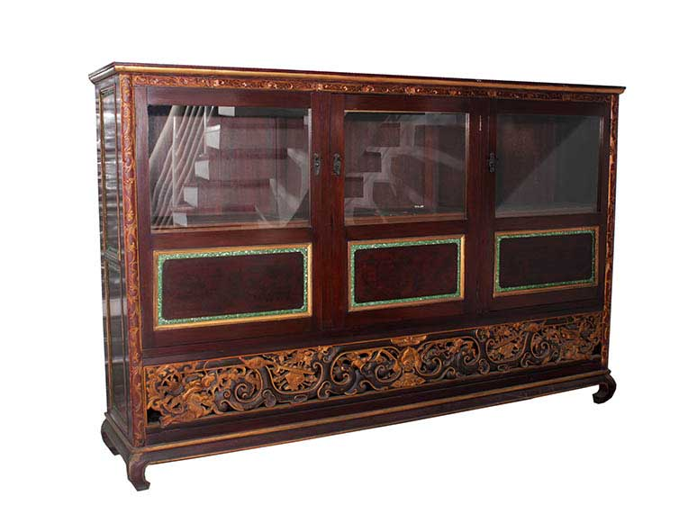 A three-door display cabinet with decoration ornaments